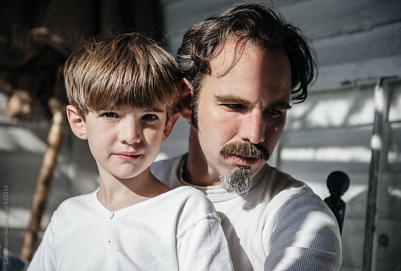 Portrait of a boy and his dad by Cara Dolan for Stocksy United