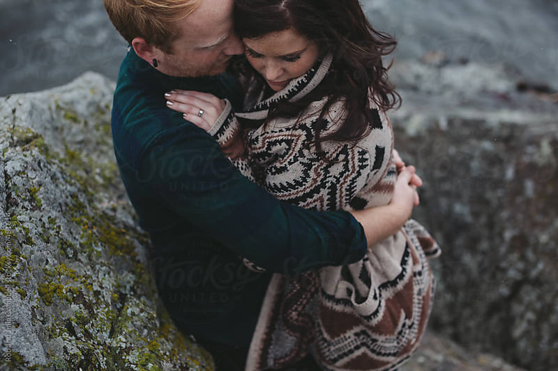 Young, stylish couple hugging together outside in west coast winter by Rob and Julia Campbell for Stocksy United