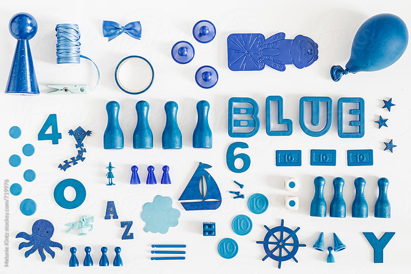 Collection of blue toys and game pieces by Melanie Kintz for Stocksy United