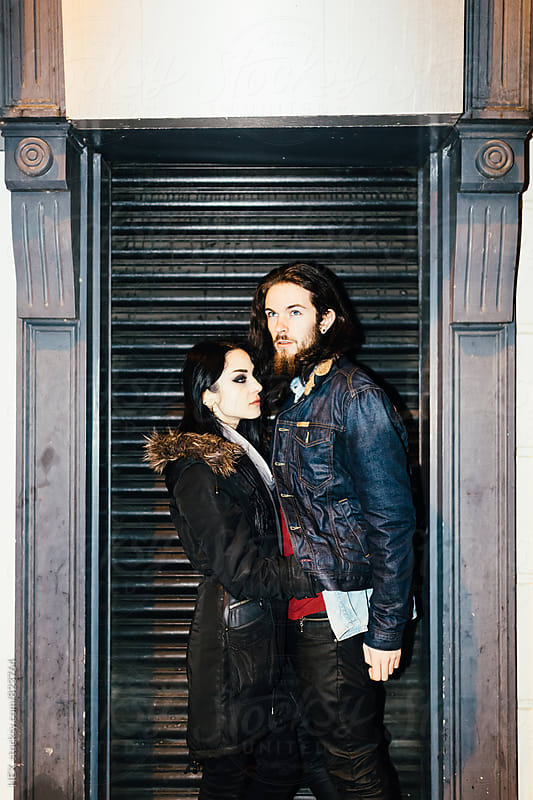 Young Couple Portrait in Front a Shop Sutter by HEX. for Stocksy United