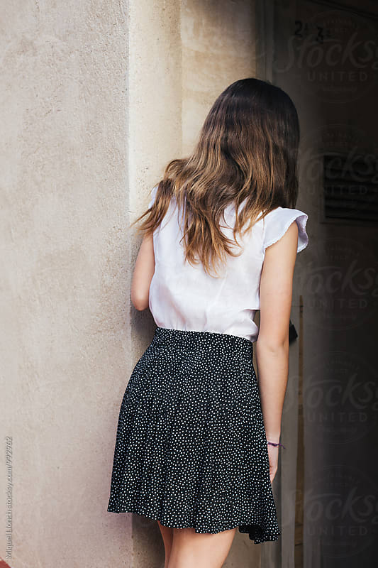 Young model woman with white shirt and black skirt by Miquel Llonch for Stocksy United