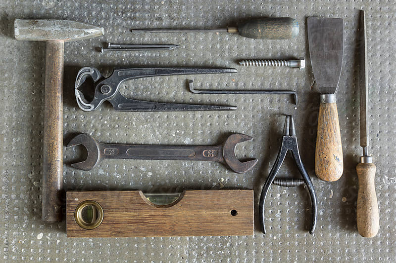 Variety of old tools seen from above by Melanie Kintz for Stocksy United
