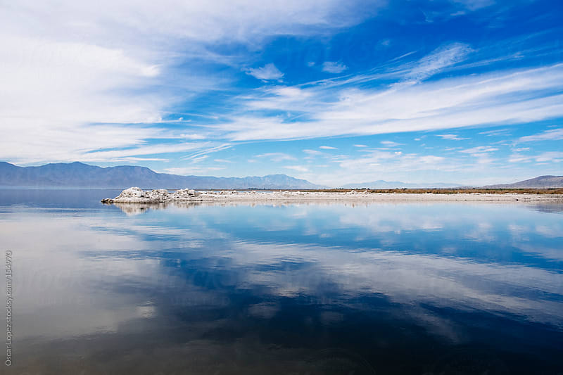 Reflection of the Salton Sea by Oscar Lopez for Stocksy United