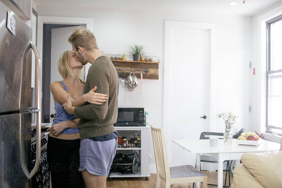 Girl Receives Kiss From Boy In The Kitchen By Joselito Briones Breakfast