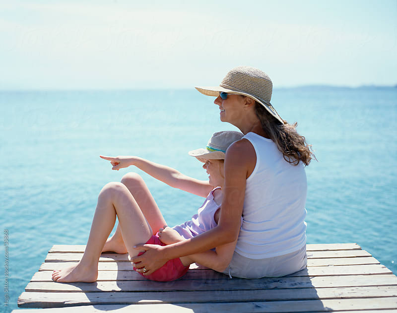 Mother and Daughter spending time together by the sea. by Hugh Sitton for Stocksy United