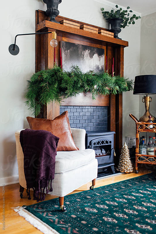 Living room decorated for the holidays by Kayla Snell for Stocksy United