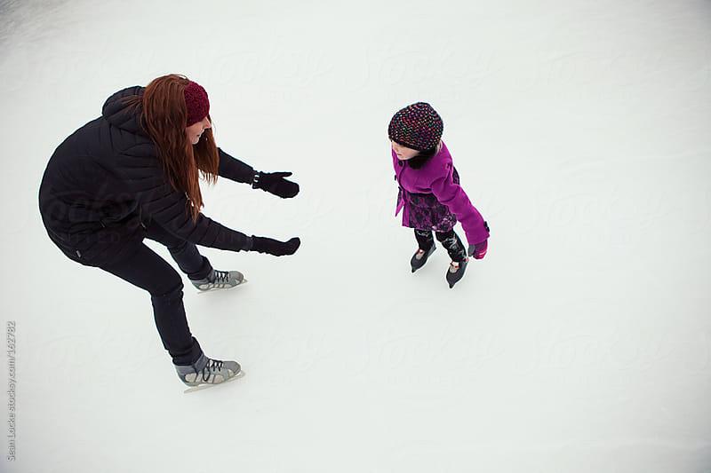 Skating: Little Girl Learning To Skate by Sean Locke for Stocksy United