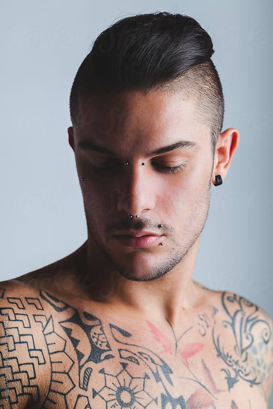 Sexy Young Man with Piercings and Tattoos, Studio Portrait by Giorgio Magini for Stocksy United