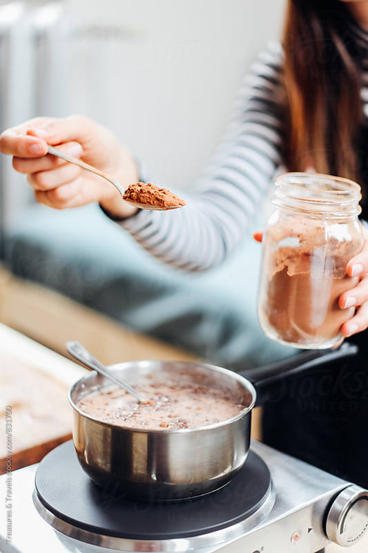 Creating hot chocolate recipe  by Treasures & Travels for Stocksy United
