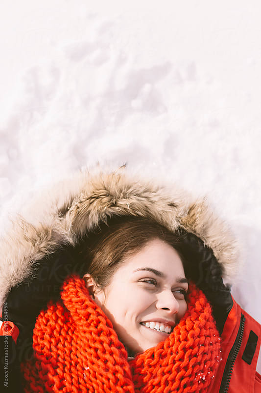 portrait of happy young woman on the snow by Alexey Kuzma for Stocksy United