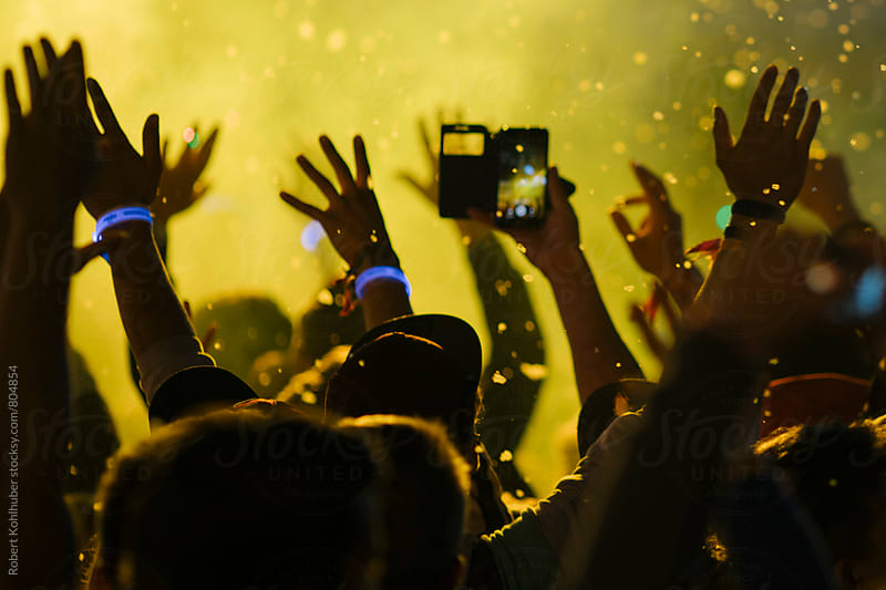 Dancing crowd at live concert, festival by Robert Kohlhuber for Stocksy United