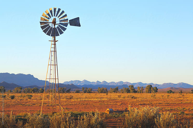 A windmill in outback Australia. by John White for Stocksy United