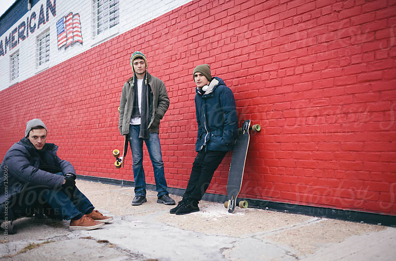 Young Men with Skateboards in Brooklyn by Joselito Briones for Stocksy United