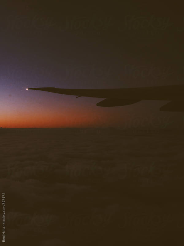Window Seat Sunrise by Benj Haisch for Stocksy United