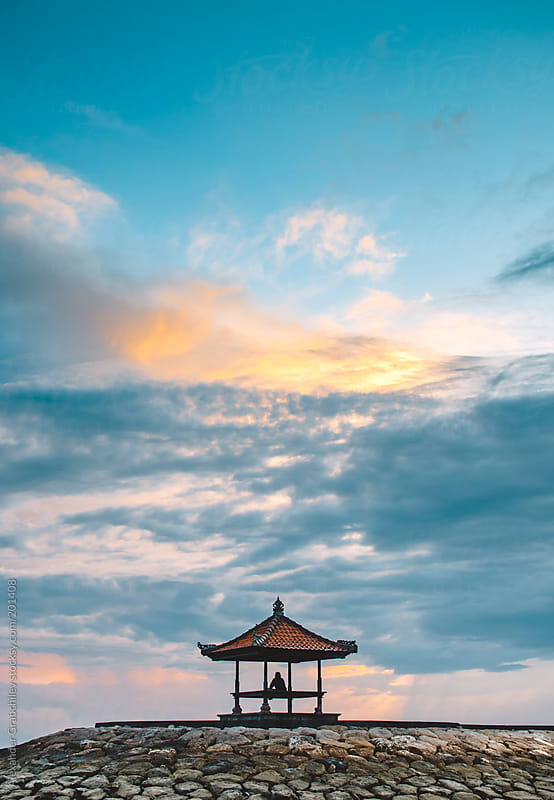 Men See Sunrise At Pagoda by Alexander Grabchilev for Stocksy United