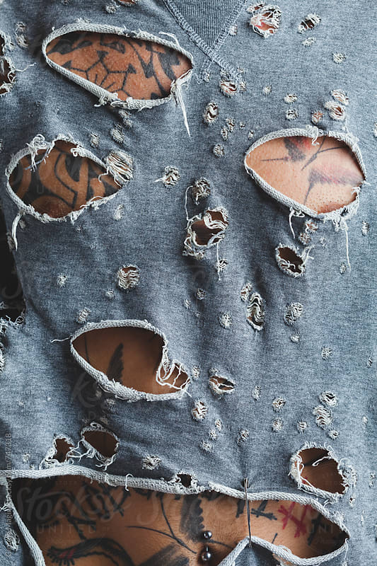 Tattooed Body Through a Ripped T-Shirt by Giorgio Magini for Stocksy United