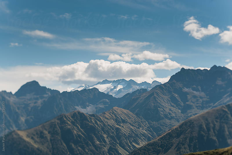 landscape with mountains and clouds by Javier Pardina for Stocksy United