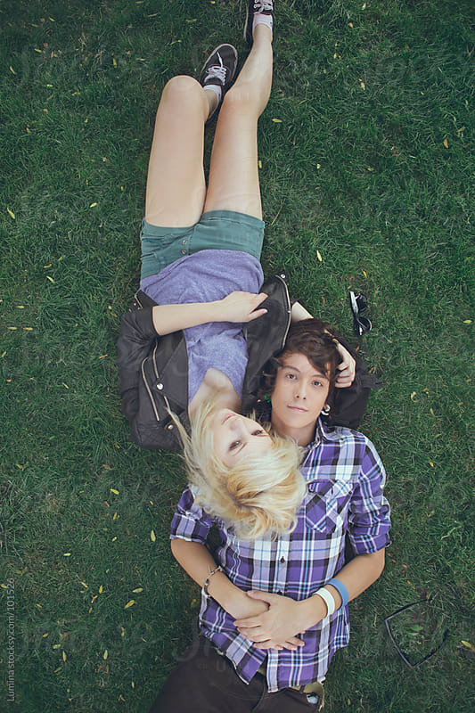 Teenage Couple Lying on the Grass by Lumina for Stocksy United