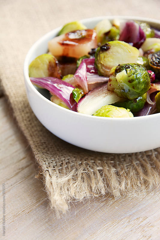 Roasted Brussels Sprouts with Pears and Red Onions and Balsamic Vinegar Sauce by Harald Walker for Stocksy United