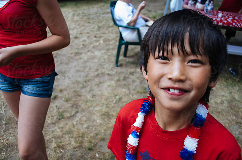 a young boy celebrates the fourth of july by Margaret Vincent for Stocksy United