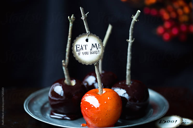 Candy apples for Halloween by Ruth Black for Stocksy United