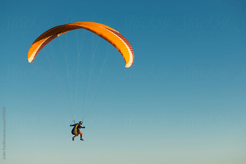 skydiver  flying in the sky by Javier Pardina for Stocksy United