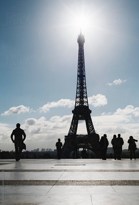 People against Eiffel Tower in Paris by GIC for Stocksy United