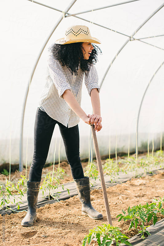 Portrait of a farmer woman in a greenhouse. by BONNINSTUDIO for Stocksy United