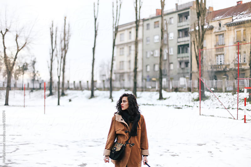 Portrait of a young woman in the street, winter  by Marija Kovac for Stocksy United