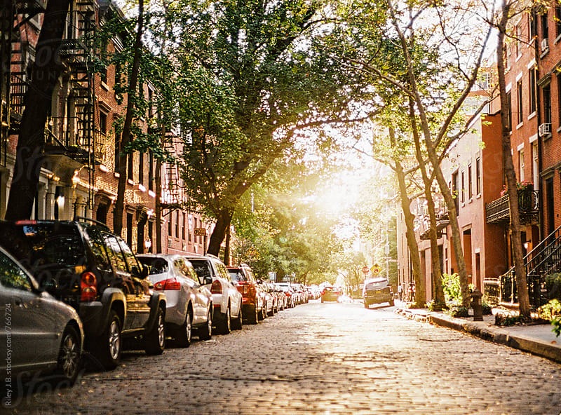 A sun bathed cobble stone street in New York by Riley J.B. for Stocksy United