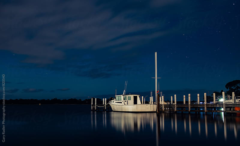 White Boat tied to a Pier at Night by Gary Radler Photography for Stocksy United