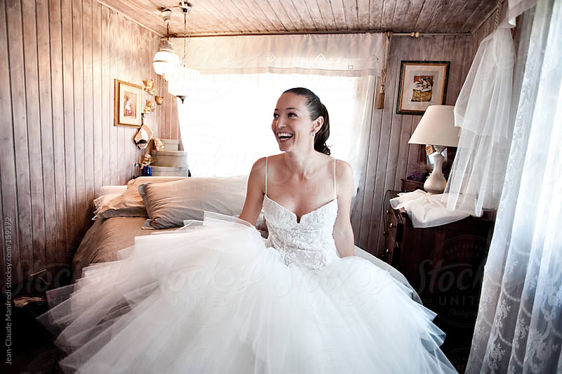 Young bride with her wedding dress by Jean-Claude Manfredi for Stocksy United