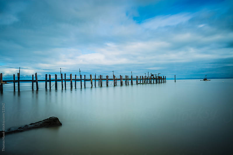 Pier and water by Thomas Hawk for Stocksy United