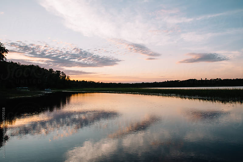 Sunset on Minnesota Lake by Justin Mullet for Stocksy United