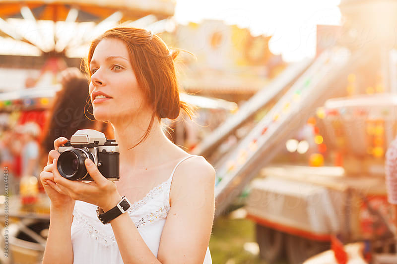Young woman photographing  at amusement park  by Aleksandra Kovac for Stocksy United