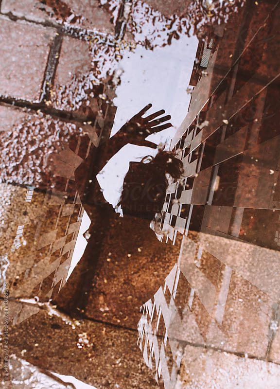Reflection on a puddle by Thais Ramos Varela for Stocksy United