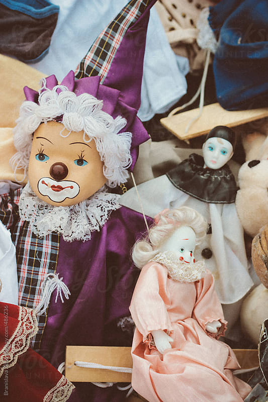 Three porcelain clowns on the vintage market by Evil Pixels Photography for Stocksy United