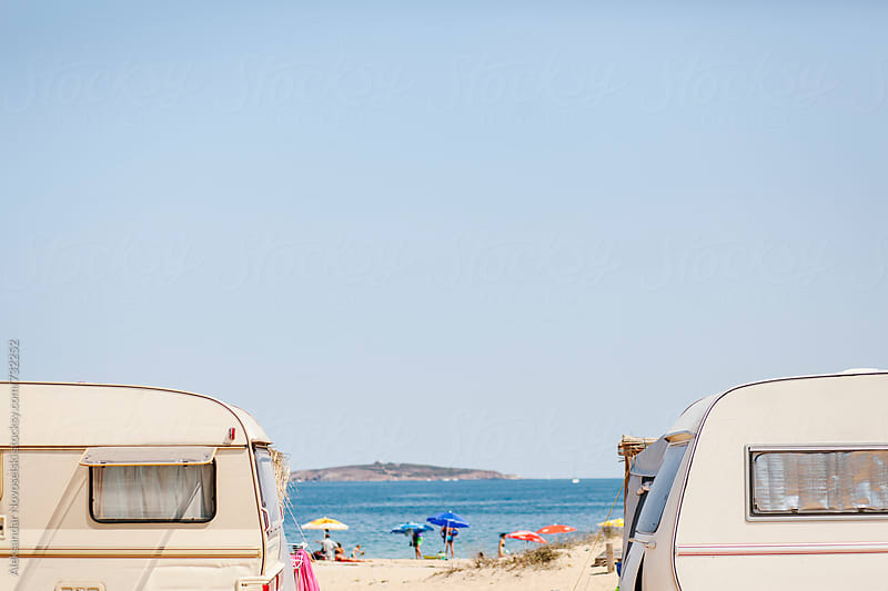 Caravans at the beach camping on a sunny day by Aleksandar Novoselski for Stocksy United