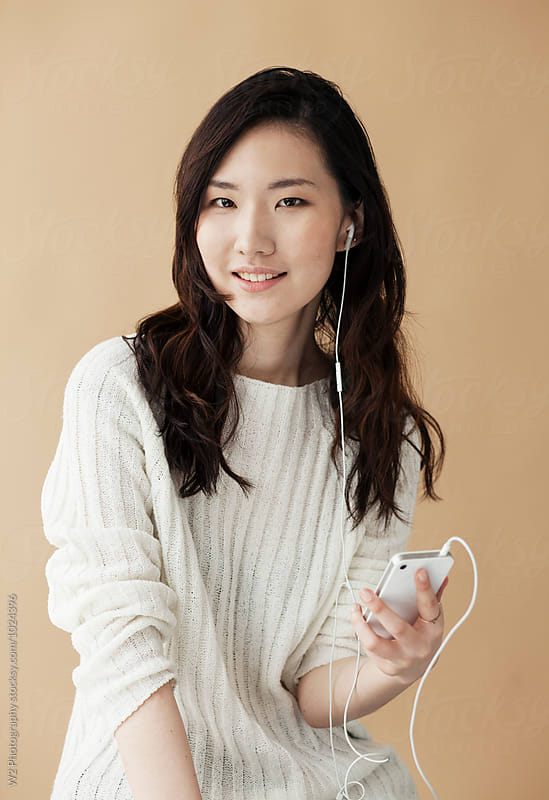 Young woman posing with smart phone. by W2 Photography for Stocksy United