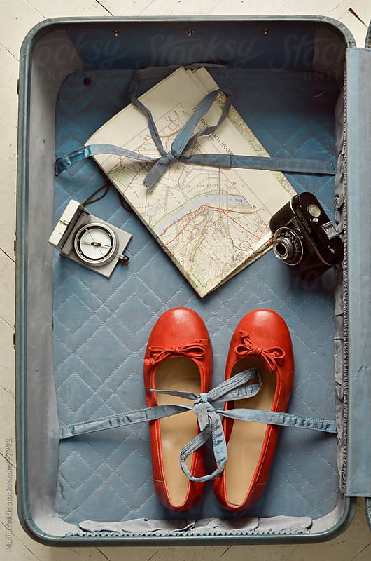 suitcase and flats ,map,compass and camera ,ready for the road by Marija Anicic for Stocksy United
