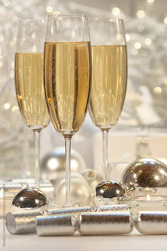Glasses filled with champagne for celebration festivities by Sandra Cunningham for Stocksy United