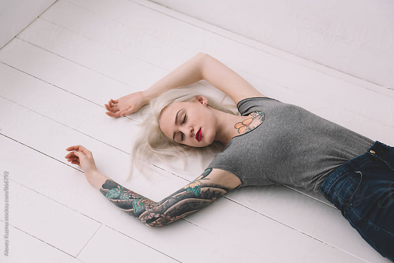 young blond woman on the white background  by Vesna for Stocksy United