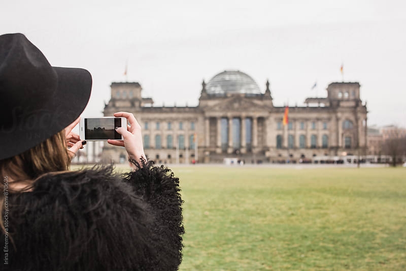 Woman taking picture of Reichstag by Irina Efremova for Stocksy United