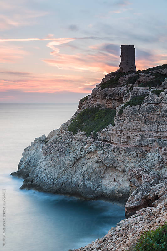 Old watchtower on the Mediterranean coast  by Marilar Irastorza for Stocksy United