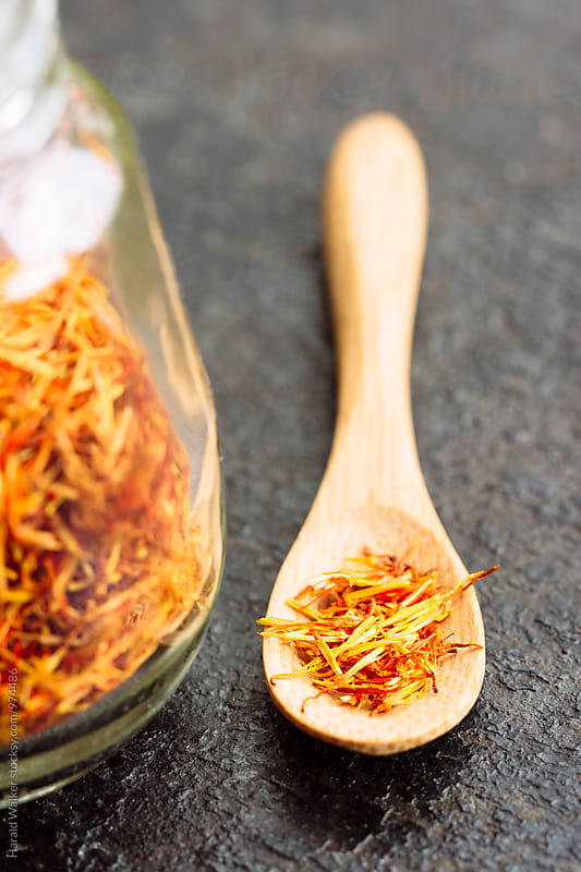 Saffron threads on tiny wooden spoon by Harald Walker for Stocksy United