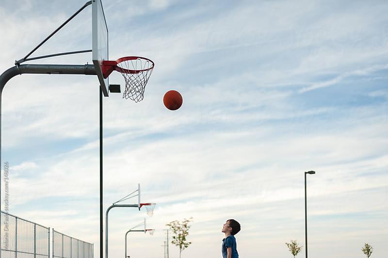 shooting hoops by Melanie DeFazio for Stocksy United