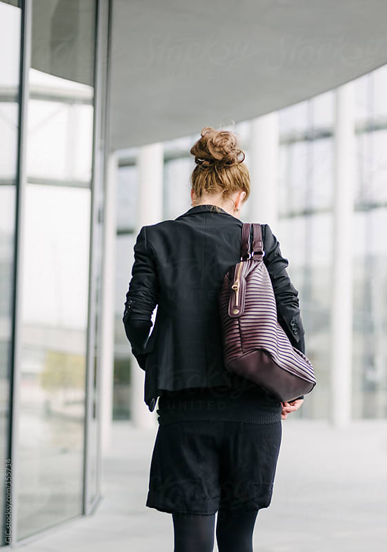 Yuoung blonde Businesswoman walking - from behind by GIC for Stocksy United