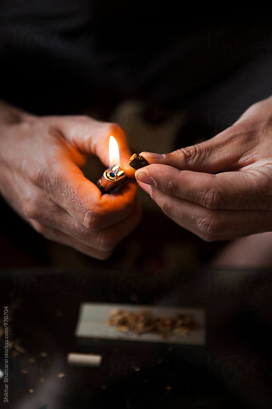 Hands of a man making a joint. by Shikhar Bhattarai for Stocksy United
