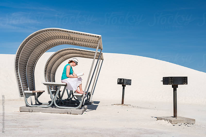 Woman Reading Book In Stark Metal Shelter at White Sands National Monument New Mexico by JP Danko for Stocksy United