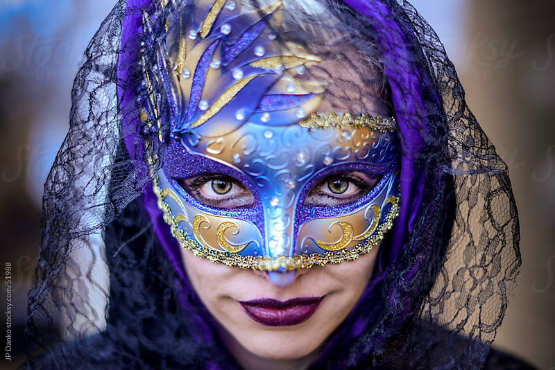 Exotic Beautiful Woman Wearing a Masquerade Mask Looking Straight at Camera by JP Danko for Stocksy United